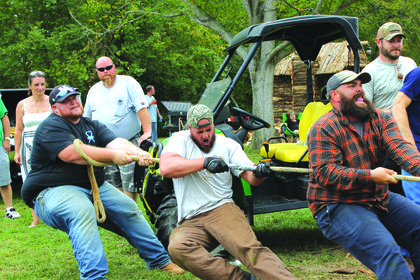 """Team """"Not That Country"""" from Campellsville University pulls together in the tug of war event."""