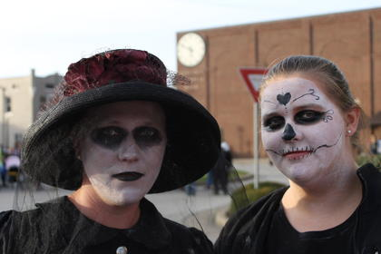 Rosa Kessinger and Makayla Jones put on their scariest faces as the woman in black and sugar skull.
