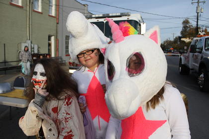 Unicorns Devyn Kessinger, 10, and Tatum Massey, 10 (right) looked a little unsure about posing with a psychomaniac, Trinity Kissinger, 12.