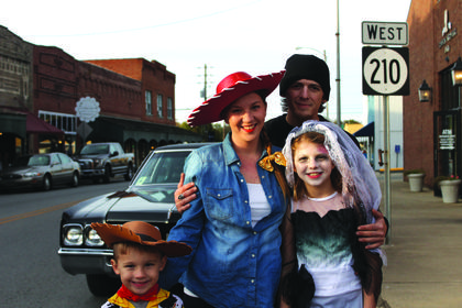 Jessie and Matthew Wright dressed up with their kids cowboy Bentley, 5 and dead bride Madison, 10.