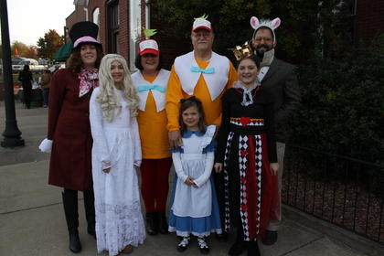 The Seadler family's Wonderland theme made for a great group costume. Pictured left to right are Celeste as the Mad Hatter, Bailey as the White Queen, Lisa and Richard as Tweedle Dum and Tweedle Dee, Jocelyn as Alice, Adelaide as the queen of Hearts and Kevin as the White Rabbit.