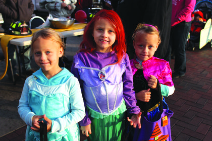 The Creason sisters dressed like princesses Elsa, Arial and Anna. Pictured from left to right are Abby, 4, Cheyanne, 7 and Emma, 4.