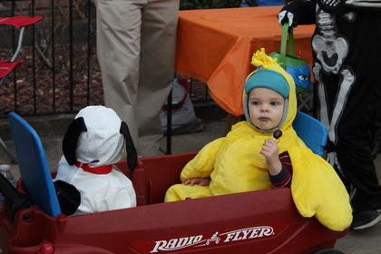 Brothers Griffin, 9 months, and Jack Nance, 23 months, rode around the square as Snoopy and Woodstock.