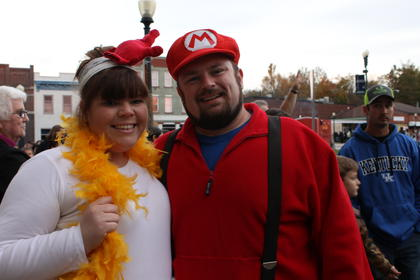Danielle and Doug Ponder dressed up as a chicken and Mario for the occasion.