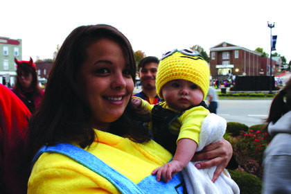 Tori Thompson and her son Nash, 5 months, donned yellow shirts and overalls for their minion costumes.