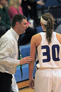 Coach Travis Wootton speaks with Allison Yingling.