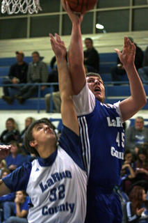 Seth DaVary (right) goes up for a layup. He is defended by Michael Obstinik.