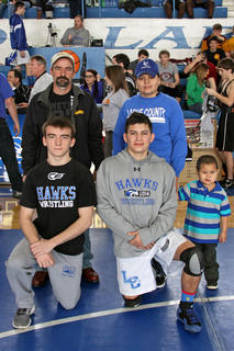 Senior wrestlers Kyle Edlin and Raymundo Perez and their parents were honored on Senior Night.