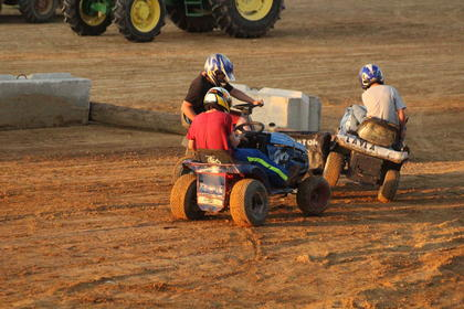 Above, three people sacrificed their time from mowing their yards to enter their riding lawn mowers in the lawn mower demolition derby on Friday, June 2.