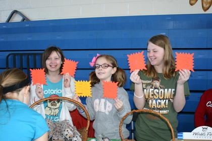Members of the 4-H Dog Club, Morgan Morris, Ashley Miller and Michaela Miller, sold homemade dog treats at the Expo.