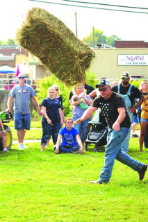 Justin Carter of Upton gives it his all during the hay toss.