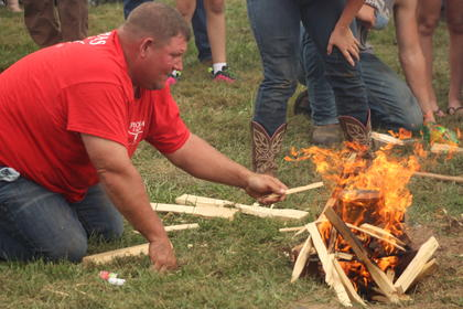 Bill Thomas of Upton fans flames during the water boil event.