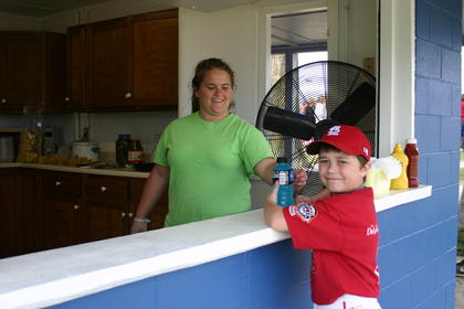 Dalton Cooper purchased a beverage from Alisha Willian at the newly refurbished concession stand.