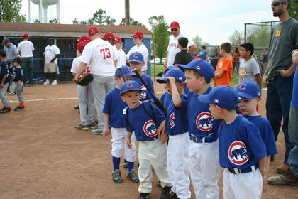 Hudson White of the Cubs talked with his teammates before the ceremonial first pitch was thrown.