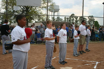 Bryson Arnette, a member of the 2013 West Kentucky 10's state champion team, stood at attention during performance of the National Anthem.