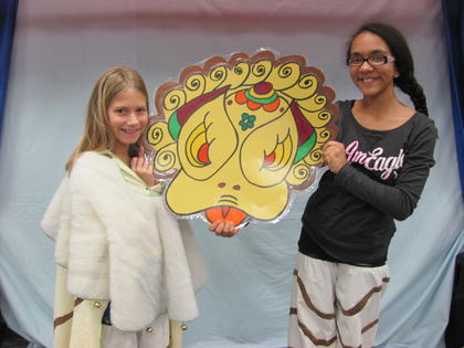 Bridgett Weaver and Bella Thurman worked hard to synchronize their movements to create a lively Chinese lion.