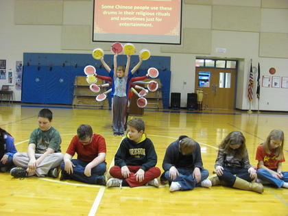 """Laura Evans' fifth-grade class performs """"The Dance of a Thousand Drums"""" using pellet drums they made in art class."""