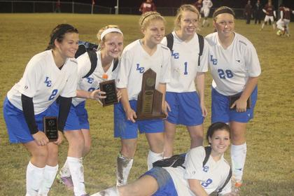 The Lady Hawks who scored five penalty points to win the district title match are from left, Shelbi Brooks, Sydney Price, Abby Modrowski, Rachel Wolf, Peyton Gardner. Goalie Sierra Mullins is in front.