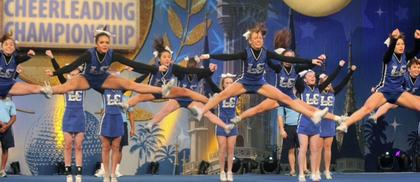 The LaRue County High School cheerleaders open with jumps during national preliminaries.