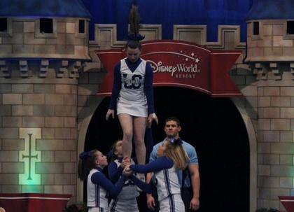 Kaylee Hornback, ponytail flying, dismounts from the first stunt in the routine and is based by Brigitte Skaggs, Ally Hutchins, and Brittany Blair.