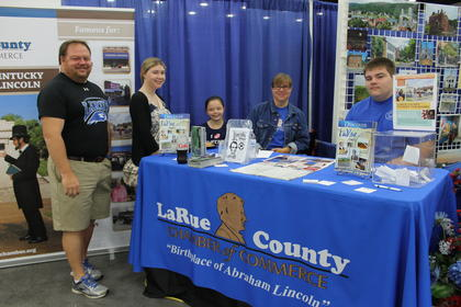 DeWayne Gibson, Abby Jennings, Lilli, Carlene and Eli Gibson were busy volunteering at the LaRue County Chamber of Commerce Pride of Counties booth.