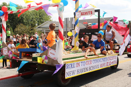 "New Haven School PTO had a ""Roll into our Carnival"" themed float for their Community Carnival"