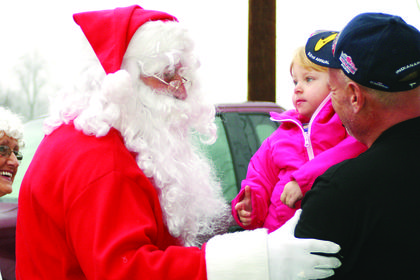 Izabella Browne, 2, was anxious to visit with Santa but did not want to sit in anyones lap.