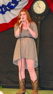 "Kailie Gary of Glendale sings ""I Told You So,"" by Carrie Underwood in the talent show."