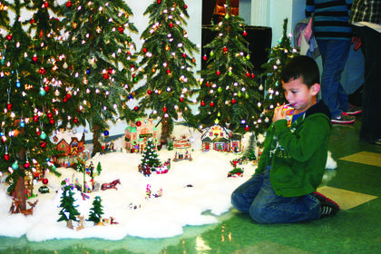 Jameson Pena-Santos, 5, admired a miniature Christmas village displayed at Hodgenville Civic Center.