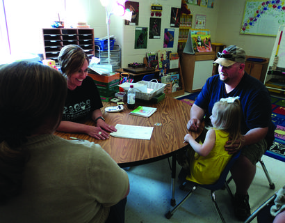 Nannette Lawler explained Aleah DeSpain's kindergarten screening to her parents, Larinda and Marshall DeSpain.