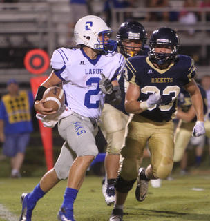 Hawk quarterback Gabe Shirley rolls out against Shelby defenders