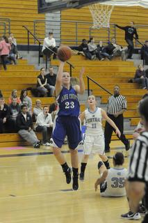 LaRue County&#039;s  Ivy Brown goes up for a shot after colliding with Central Hardin&#039;s Aecha Helm.