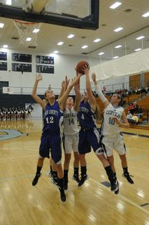 LaRue County's Alisha Durbin and Haley Holt battle for a rebound with Central Hardin's Marlee Kolley and Kasey Smallwood.
