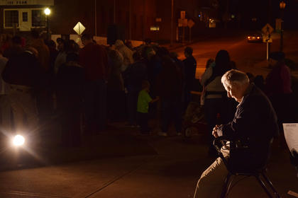 At the pre-election prayer service held on the Square in Downtown Hodgenville, this man was seated in front of the light. There were nearly 100 people in the background worshiping and praying but this one man praying right in front of the statue, to me, really captured what the event was about.