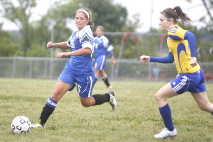 LaRue County High School senior Megan Smith made a move down field on  