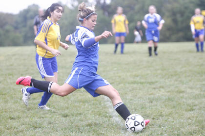 LaRue County High School sophomore Shelbi Brooks advanced the ball  