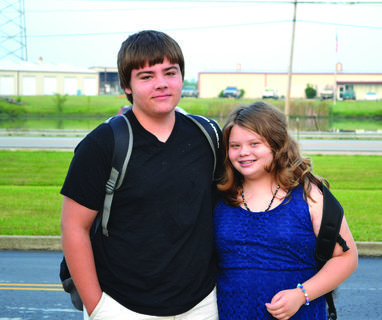 Freshman Eli Gibson said goodbye to his sister Abi on her first day in middle school.