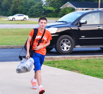 With school supplies in hand, seventh-grader Simon Coy was ready for the first day of school.