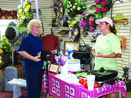 Denise Martin provided samples of goat meat at Lee's Garden Center.