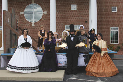 Group Photo of all members from A & B in the parade: Front Row: Jennifer Collins, Amber Florence, James Bryant, and Amanda Houk. Second Row: Landon Pierce, Raina Pierce, Jennifer Williams, Chasity Woods, Brendon Nuegent, & Maverick Houk.