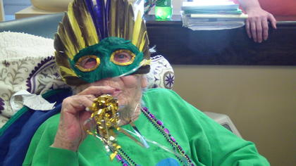 Sunrise Manor residents enjoyed a Mardi Gras party March 4. Barbara Graham donned a mask for the event.