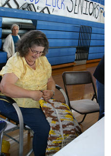 Connie Gardner, a member of the Nifty Needles sewing group, held a demonstration at the Extension Expo, crocheting plastic grocery bags into sleeping mats for the homeless. The mats provide a lightweight, damp-proof barrier between the person and the ground.