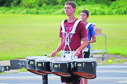 Matthew Warren beats on the quad drum.
