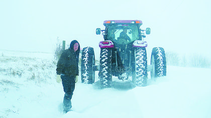 Rex and Martha Read came to the rescue of Roger and Melanie Wells whose truck was stuck in a drifted snow bank.