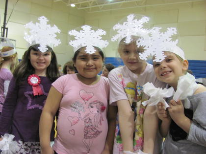 "Hodgenville Elementary first-graders performed ""The Mitten"" recently. Students from Angela DeVore's class portrayed snowflakes. From left, Marissa Muss, Marlene Salazar, Lorelai DeBarge and Hannah Owens."