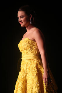 Montana Metcalf sports a bright yellow dress during the self-expression portion of the Distinguished Young Women program Saturday.