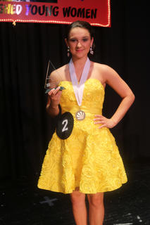 Montana Metcalf sports her medal and award after winning the honor of Distinguished Young Woman for LaRue County.