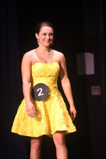 Montana Metcalf grins as she walks across the stage after being named LaRue County's Distinguished Young Woman for 2014.