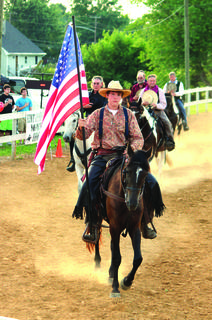 The Cowboy Sports Association (Mounted Shooters) performed June 25 at the LaRue County Fair. Participating in the opening ceremony, are Rod McCracken, Wade Hagan (holding flag), Doyle Gibson, Gary Woolridge and Phil Clayton.