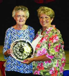Wilma McDowell was named Mother of the Year, a recognition sponsored annually by the Homemakers. Her longtime friend, Patsy Thomas, presented her with a silver tray.